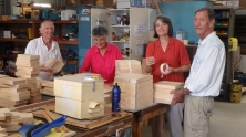 Kevin, Ann, Laura & Lauri bundling bee sets at Mens Shed